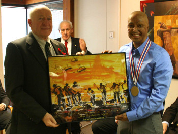 Academy Trustee Don Wukash (left) presents the painting 